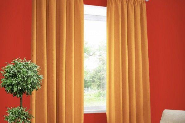 Оранжевые шторы: применение в интерьере детской, гостиной и кухни, фото