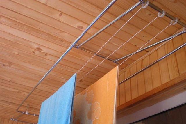 Сушилка для белья на балкон: потолочная, настенная, напольная, виды, фото